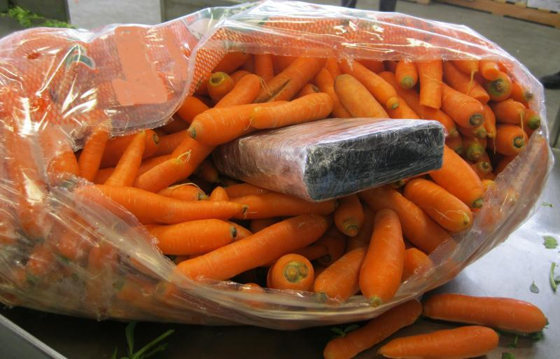 A cocaine package is visible within a bag of carrots. CBP officers seized a total of 164 pounds of cocaine hidden in a carrot shipment at Pharr-Reynosa International Bridge.