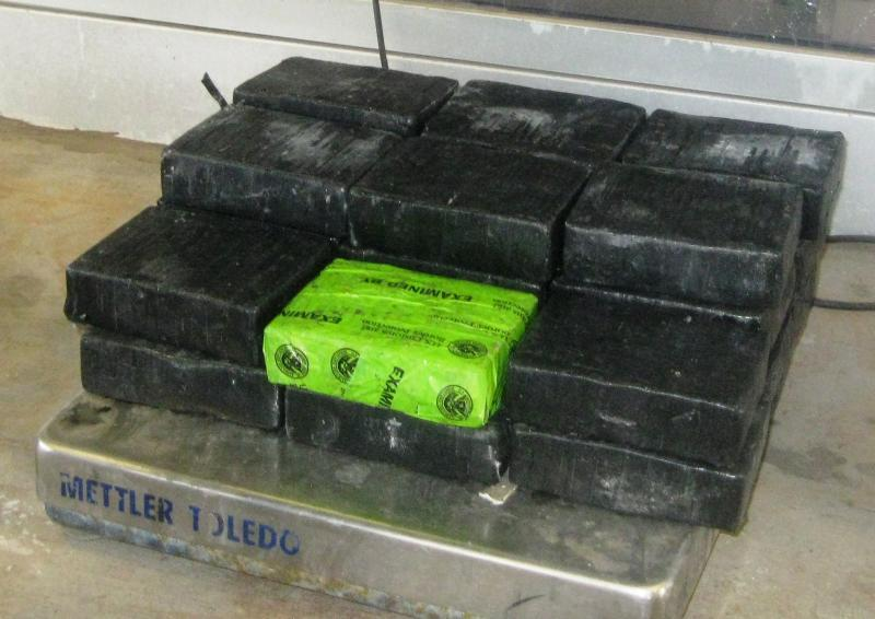Bundles containing 50 pounds of cocaine seized by CBP officers in a tractor at the Pharr-Reynosa International Bridge