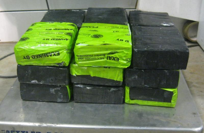 Bundles containing 37.21 pounds of cocaine seized by CBP officers within the batteries of a commercial tractor at Pharr-Reynosa International Bridge