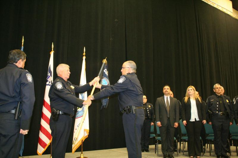 David John Gonzalez formally assumes command as port director of Rio Grande City Port of Entry by taking possession of the Laredo Field Office guidon from Director, Field Operations David P. Higgerson, Laredo Field Office during a Change of Command ceremony.