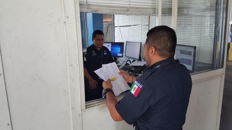 Officers with Servicio de Administración Tributaria, Aduana de Nuevo Laredo conduct temporary coordinated inspections in collaboration with CBP at World Trade Bridge import lot dock as part of ongoing binational business resumption efforts
