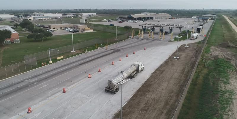 Image of commercial trucks utilizing the new inbound lanes created through the pavement expansion project at Veterans International Bridge