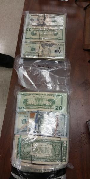 Packages containing $57,691 in unreported currency seized by CBP officers at Brownsville Port of Entry