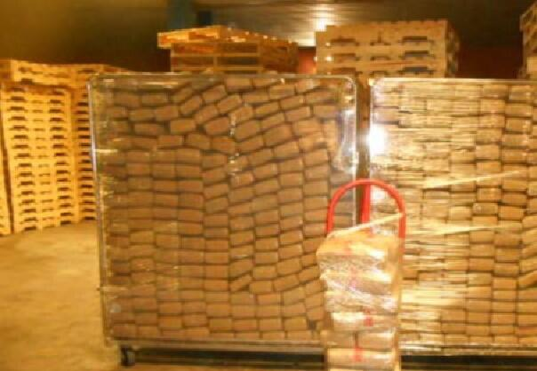 Bundles containing 2,788 pounds of marijuana seized by CBP officers at Laredo Port of Entry in the roof of a tractor