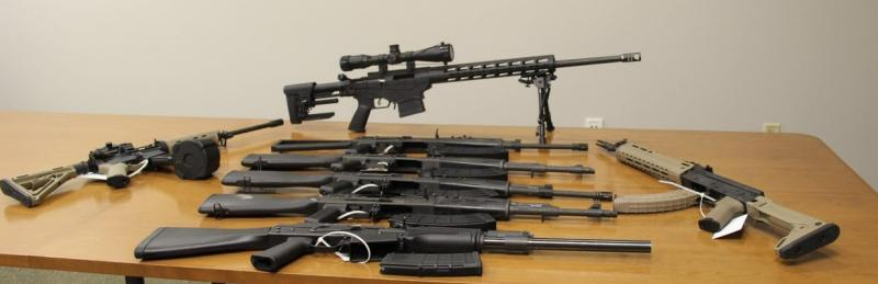 A cache of eight semi-automatic weapons, eight magazines and two scopes seized by CBP officers at Del Rio Port of Entry during an outbound examination.