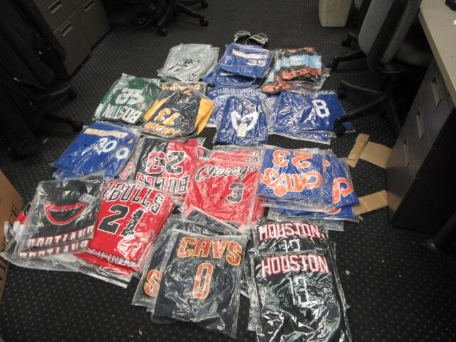 Jerseys with NBA team logos seized by CBP officers and import specialists assigned to the Apparel, Footwear and Textiles Center for infringement of the NBA trademark