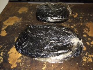 Two bundles containing nearly 11 pounds of heroin seized by CBP officers in Laredo.