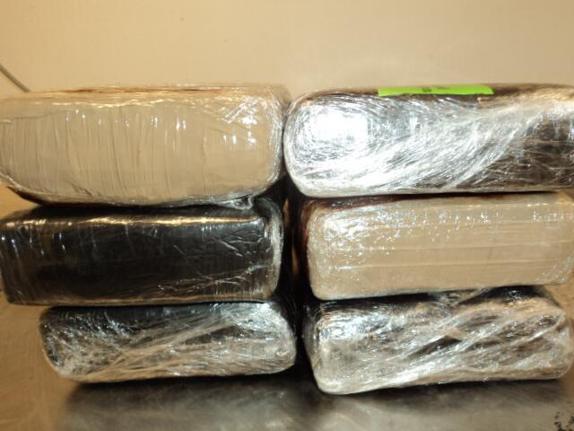 Bundles containing nearly 16 pounds of cocaine seized by CBP officers from a tractor cab at World Trade Bridge  in Laredo, Texas