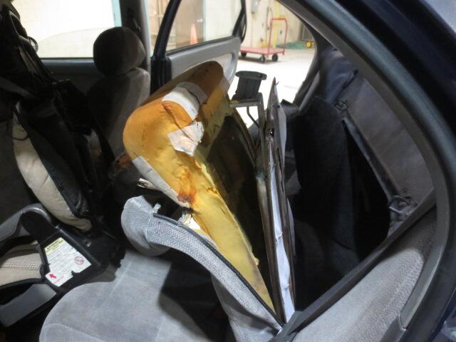 CBP officers discover cocaine filled bundles in cushion of rear seat.