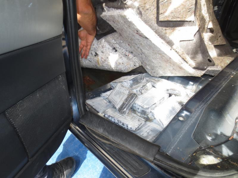 Drug bundles in floor of car