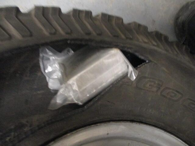Drug bundles in spare tire.