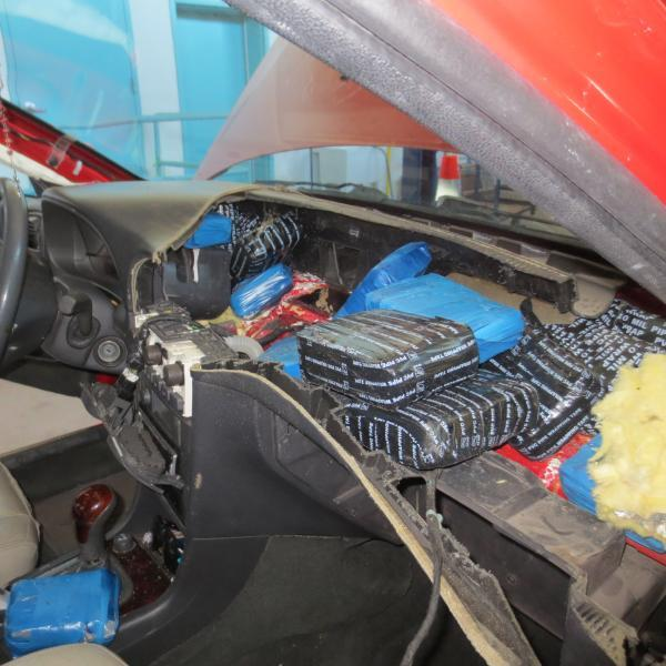 CBP officers discover drugs in vehicle dashboard.