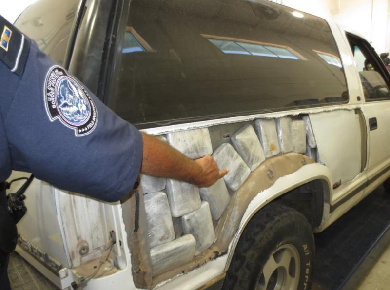 CBP officers discover drug filled bundles in the side panels of a vehicle.