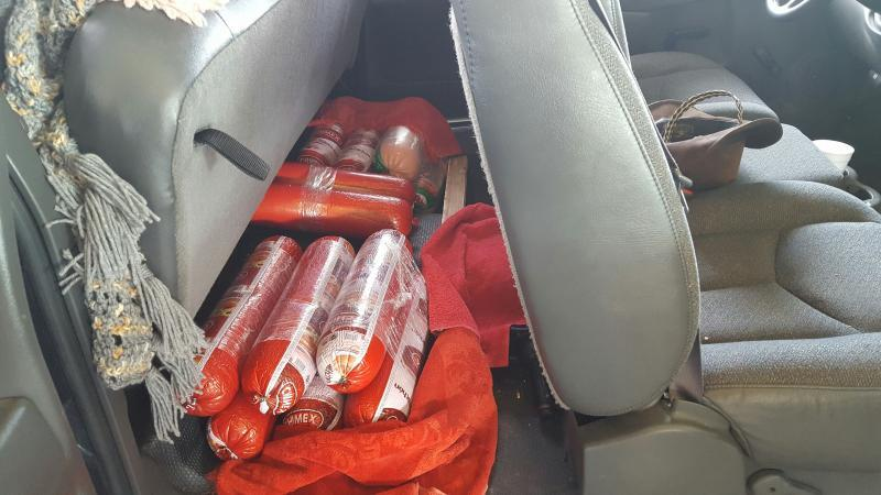 Rolls of bologna in vehicle.