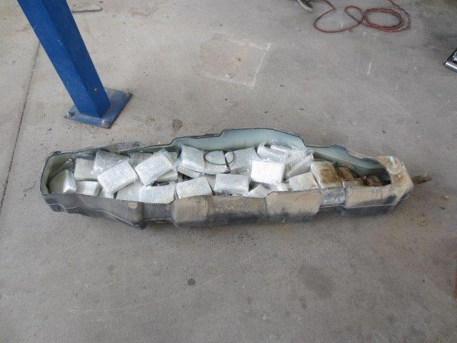 CBP Officers discover marijuana in fuel tank.