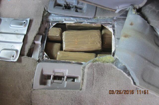 CBP officers discover a drug load in floor of a van.