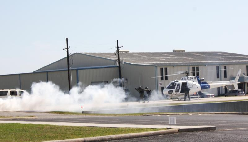 CBP helicopter brings HSI agents amid smoke