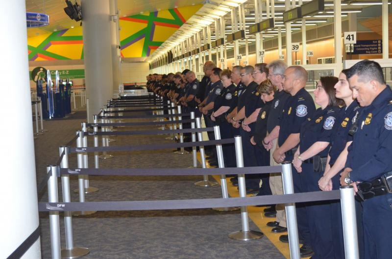 CBP officers stand in line