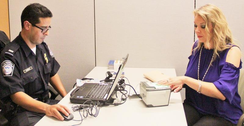 CBP officer enrolls Woodlands resident in the Global Entry program.
