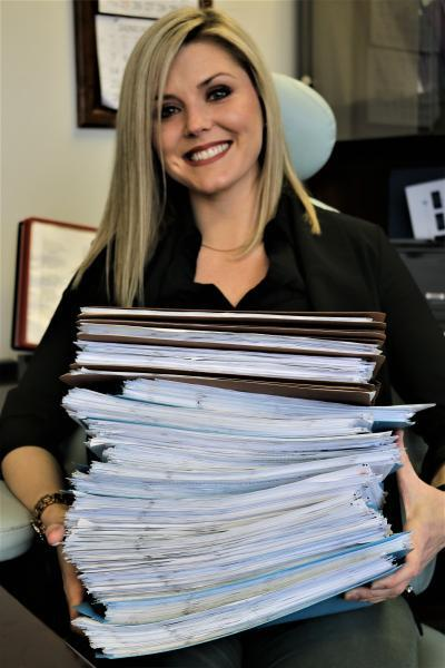 Stacks of folders holding telephone bills