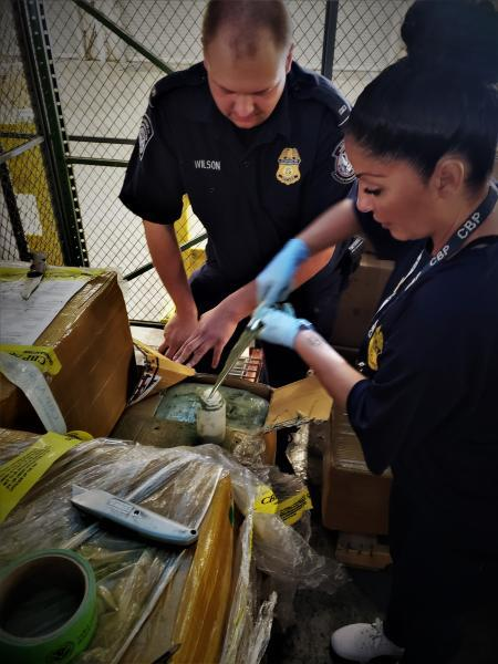 CBP Agriculture and Import speciaists getting sample of seized Kratom