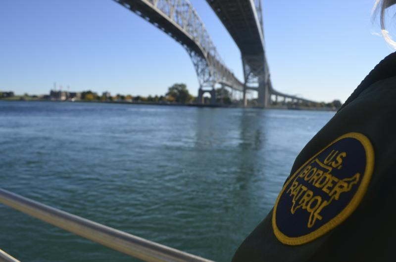 Border Patrol Agent looks out at the St. Clair River in Port Huron, MI