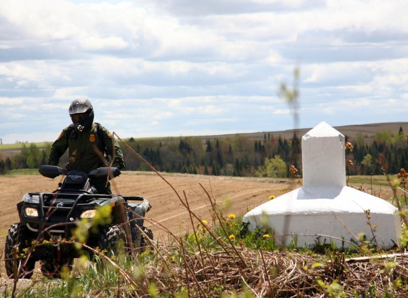 A Houlton Sector Border Patrol agent patrolling the U.S./Canada border on an ATV in Maine.