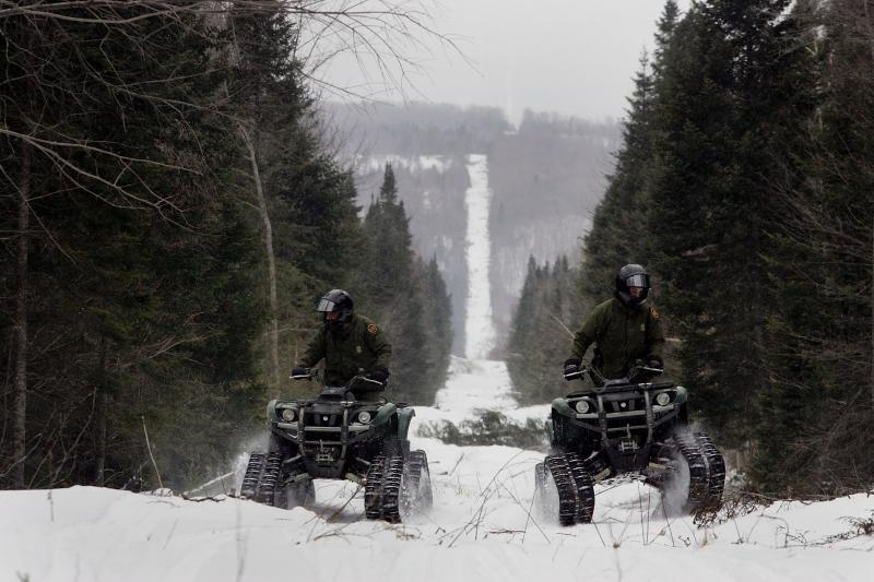 U.S. Border Patrol agents from the Beecher Falls Station patrolling the international border.