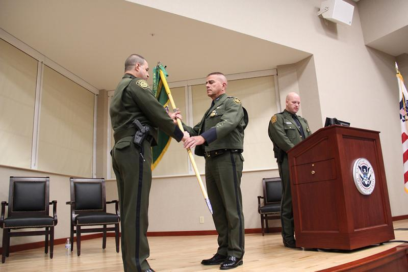 Chief Fisher passing the Guidon to Chief Patrol Agent Daniel R. Hiebert.