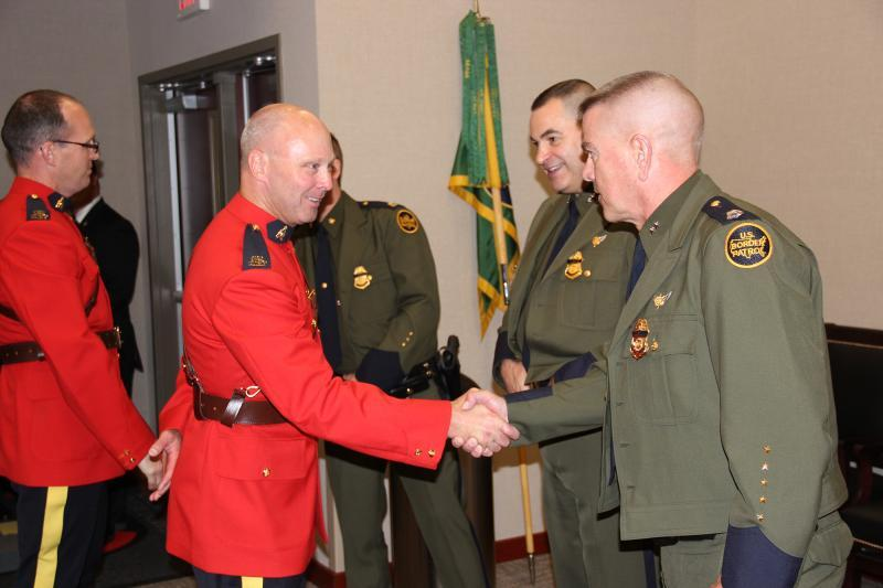 RCMP officials congratulating Chief Patrol Agent Daniel R. Hiebert on his newly appointed position with Houlton Sector.
