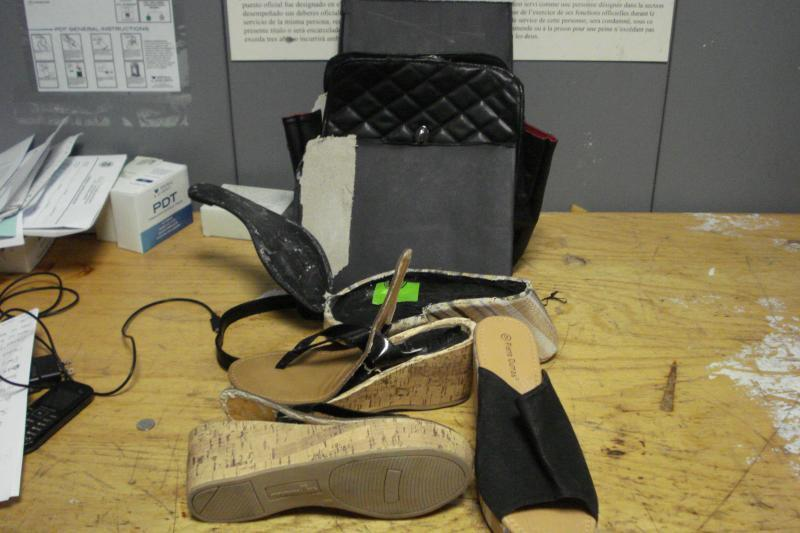 shoes and pocketbook in which cocaine was hidden