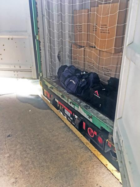 A multi-agency team discovered four bags with a combined 333 pounds of cocaine inside a shipping container at the Port of Baltimore June 18, 2019.