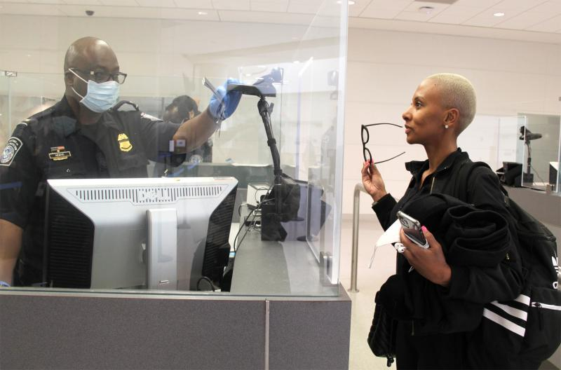 A traveler processes her admission using CBP's enhanced biometric facial comparison process at BWI Airport.