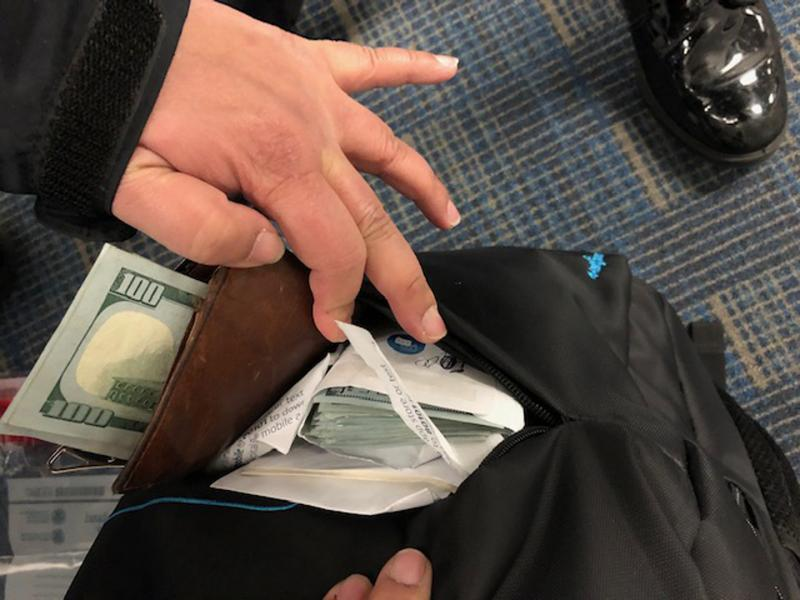 CBP officers discover unreported currency in a traveler's backpack.