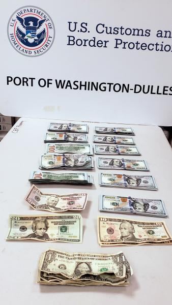 Customs and Border Protection officers seized $11,097 in unreported currency from a traveler who arrived from South Korea at Washington Dulles International Airport February 9, 2020.