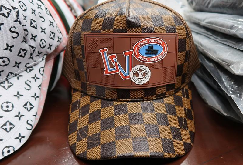 0cdfbf7bc This Louis Vuitton hat is among the 450 counterfeit hats CBP seized.