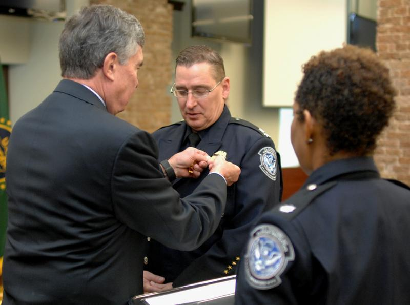 CBP Commissioner R. Gil Kerlikowske (left) pins a Director's badge on Steve Stanioha, CBP's new Director of the New Orleans Field Office, on January 14, 2016.