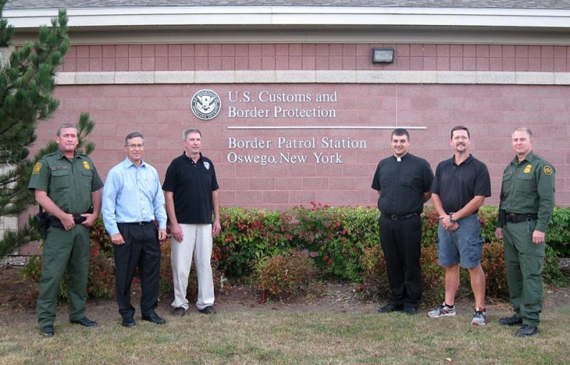 Group photo following conclusion of Oswego, N.Y. Border Patrol Station's first Cisitzens Academy. From left to right, Supervisory Border Patrol Agent Marty Lilly, George Allen, Paul VanDyke, Rev. Gregory Kreinheder, Shane Broadwell and Border Patrol Agent Steven Glenn.