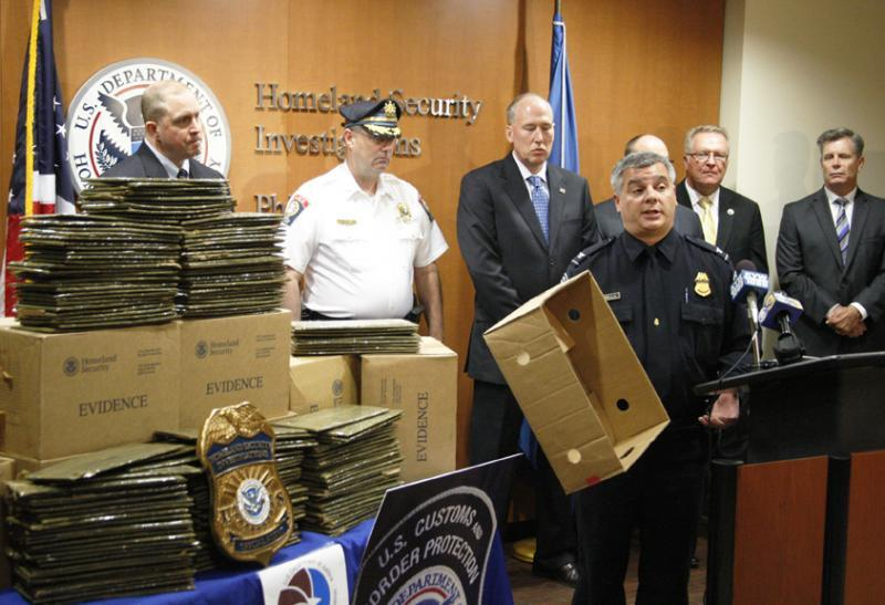 CBP Assistant Port Director Paul Nardella shows reporters where the cocaine was concealed during a media event in Philadelphia Sept. 23, 2015.