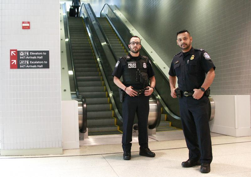 CBP Officers Luis Castineiras (left) and Mohammed Sajib.