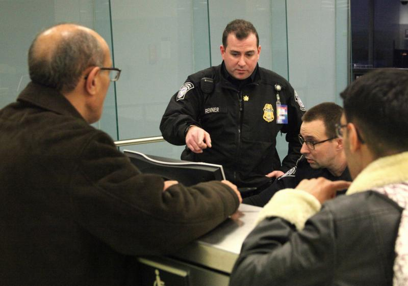 SCBPO Robert Renner (center) assists in inspecting arriving international travelers at Philadelphia International Airport January 10, 2018.