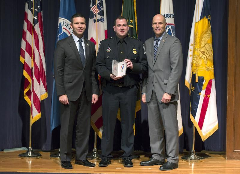 SCBPO Robert Renner (center) is presented the CBP Commissioner's Integrity Award from Acting Commissioner Kevin K. McAleenan (left) and Acting Deputy Commissioner Ronald D. Vitiello in Washington, D.C. December 7, 2017.