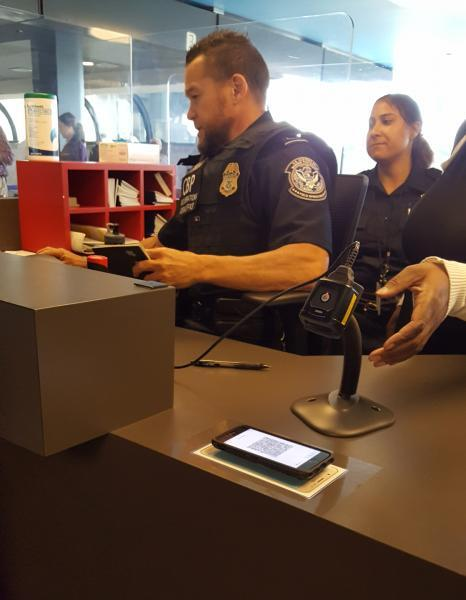 CBP officer processes a traveler's return to the U.S. using the newly launched Mobile Passport Control at Pittsburgh International Airport June 14, 2018.
