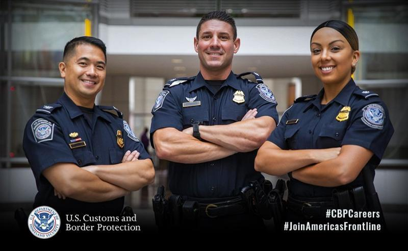 CBP recruiting poster showing three officers standing together with folded arms