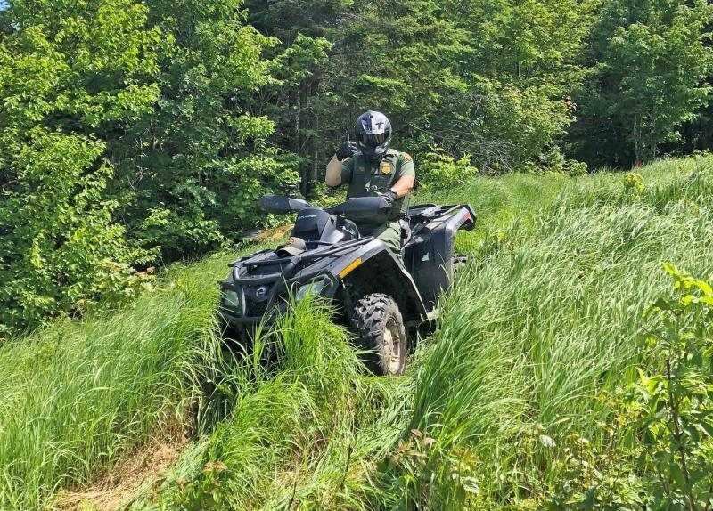 Houlton Border Patrol Sector (Maine) agent patrols the international border on an all-terrain vehicle in Maine. (file photo).