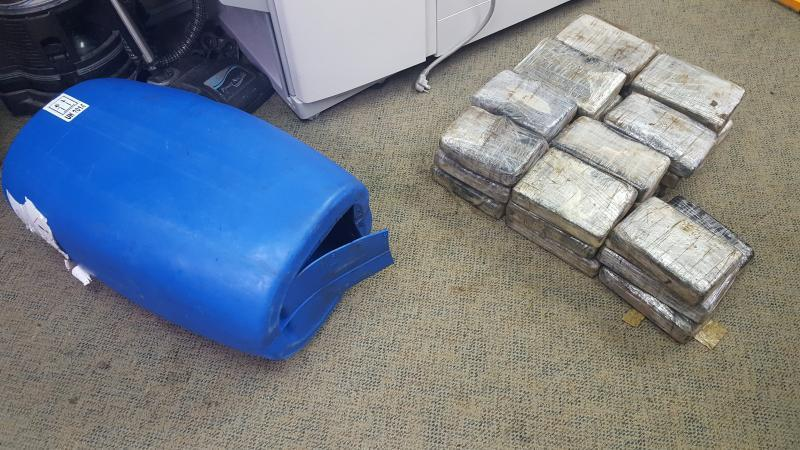 A gasoline container along with cocaine bricks retreived from the sea.