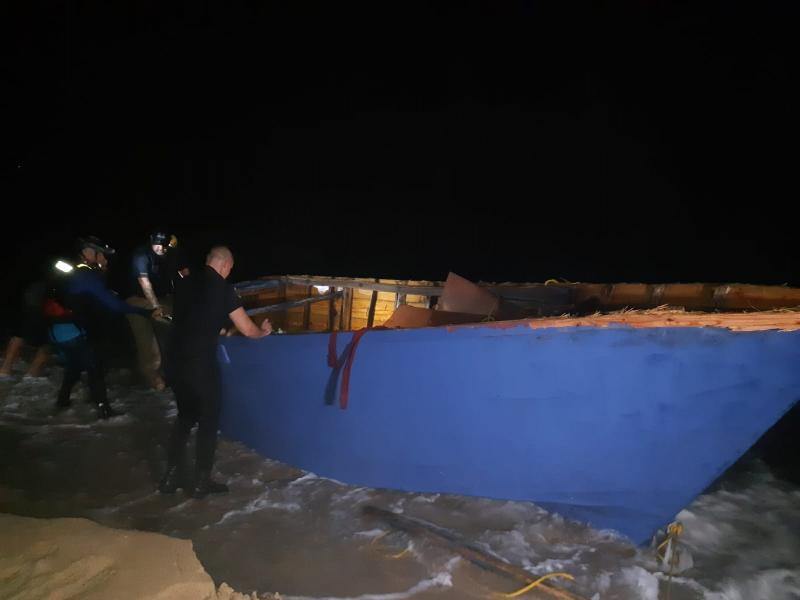 Local partnes revise the yola vessel that capsized near Aguadila, Puerto Rico