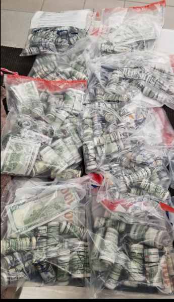 Rolls of dollar bills found inside the rails of suitcases