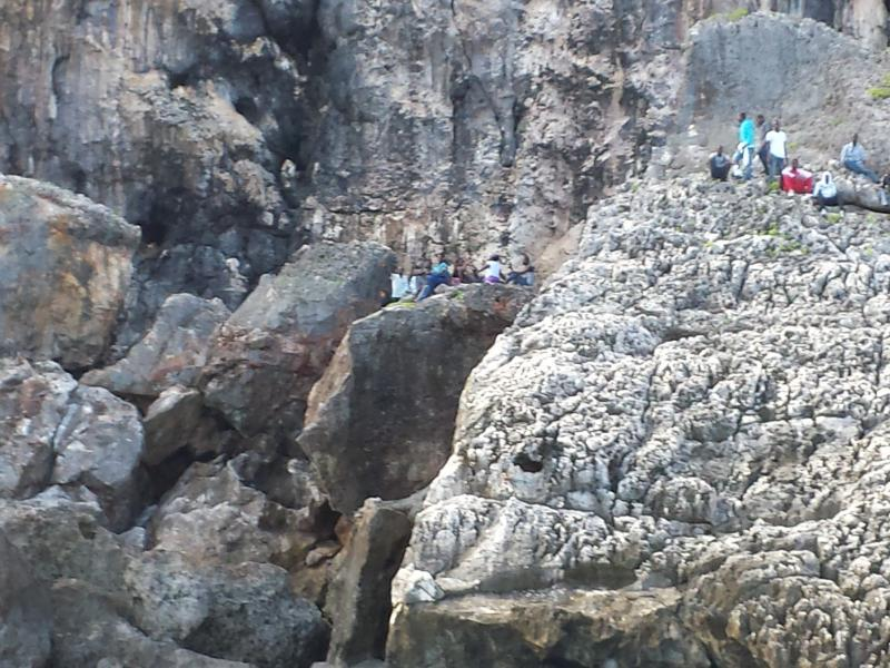 Migrants are left stranded by smugglers in the rocks in Mona Island