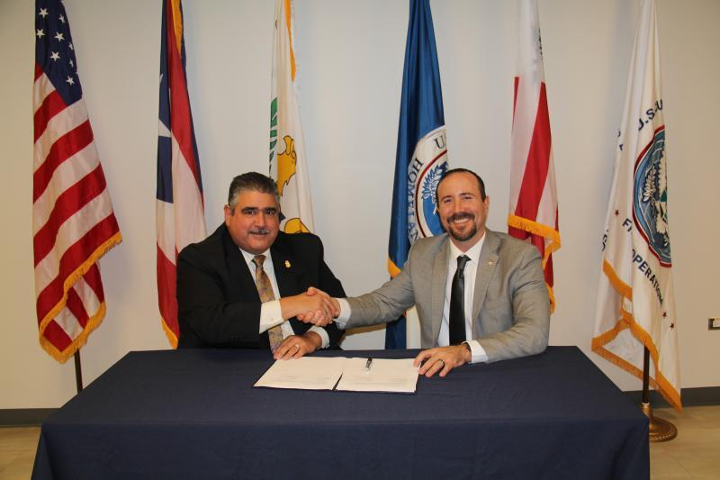 DFO Marcelino Borges (left) and SAC Ricardo Mayoral (right) after the signing of the TECC